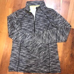 Semi fit Xersion front zip shirt.